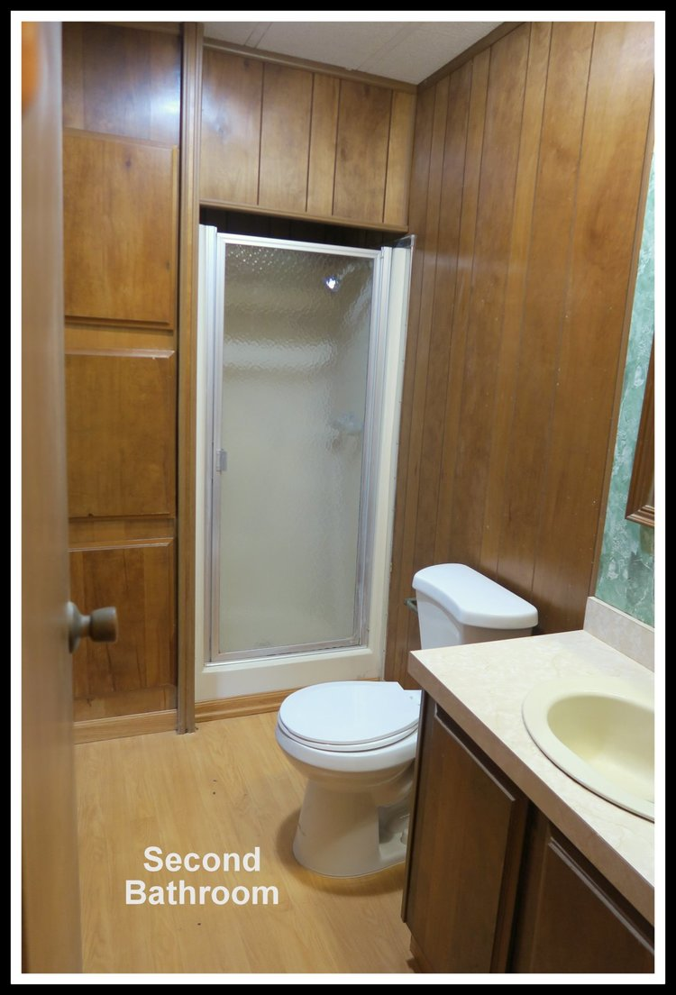 family toilet seat wood.  living room and dining roomDriveway enough for two large vehicles Upgraded Both Inside outside An ideal comfortable home a growing family Stockton Verde Mobile Home Park